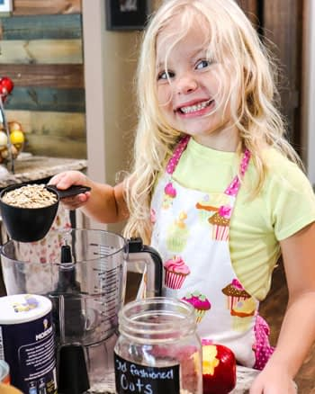 Caitlin's daughter helping with making the Pumpkin Pie Oatmeal Cookies