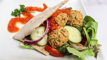 air fryer falafel in a gyro with red pepper coulis