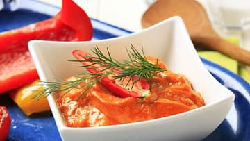 Red pepper coulis in a bowl close up