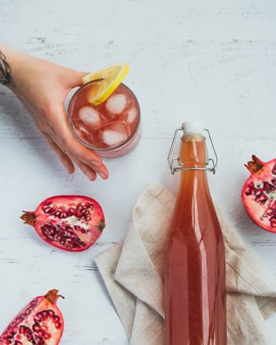 kombucha in a glass with pomegranates