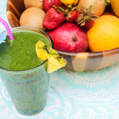 Tropical Spirulina Smoothie with fresh tropical fruits in the bucket