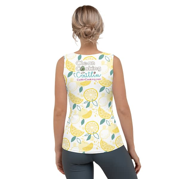 """Female model in athletic shirt with yellow lemons, logo and inscription """"Plant-based Athlete"""" CaitlinCooking.com - from the back"""