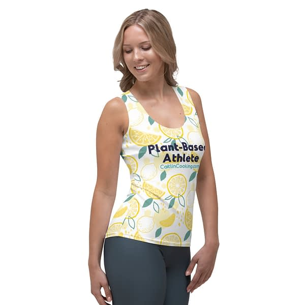 """Female model in athletic shirt with yellow lemons, logo and inscription """"Plant-based Athlete"""" CaitlinCooking.com"""