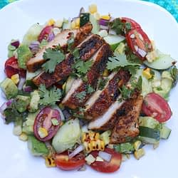 Grilled Cajun Chicken Salad on the white plate