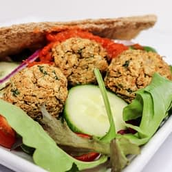 air fryer falafel nestled in a bed of salad in a gyro