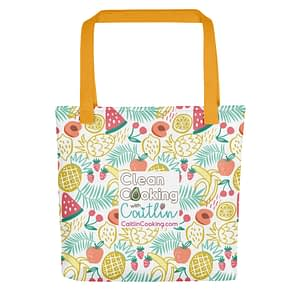 Shopping bag with colorful fruit and logo, and orange handles