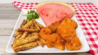 Air Fryer Crispy Buffalo Cauliflower served with French fries and watermelon