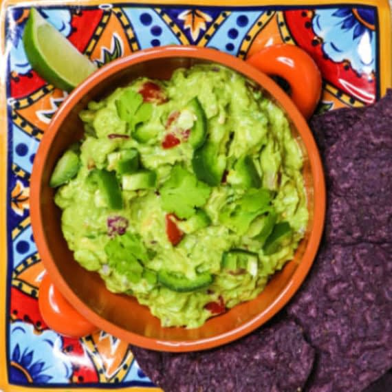 tasty guacamole with tomatoes